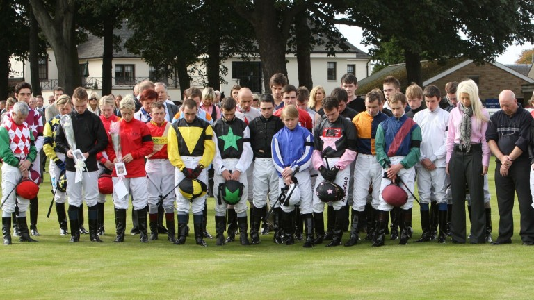 Jockeys at Ayr pay their respects to Jamie Kyne and Jan Wilson shortly after the fire in 2009