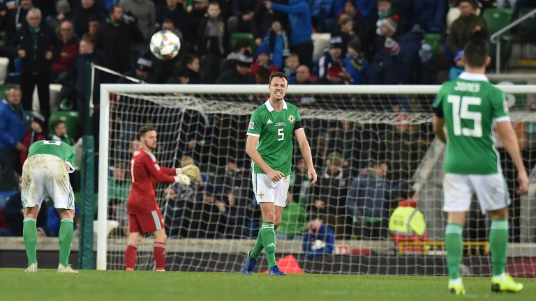 Jonny Evans of Northern Ireland screams in anguish after his side conceded a late against Austria