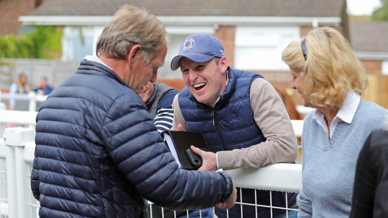 Michael Bell signs the docket as Billy Jackson-Stops and Sara Cumani look on