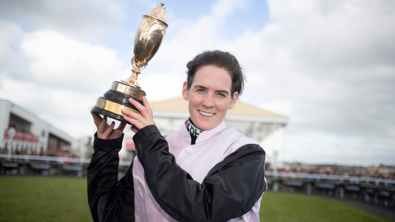 Party time: Rachael Blackmore holds the trophy aloft after victory in the Kerry National on Poker Party
