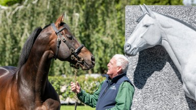 INVINCIBLE SPIRIT (Green Desert - Rafha) with Michael Daffer Kelly in front of the Invincible Spirit statue created by artist Simon Carmen. Photo by Bronwen Healy.  The Image is Everything - Bronwen Healy Photography.