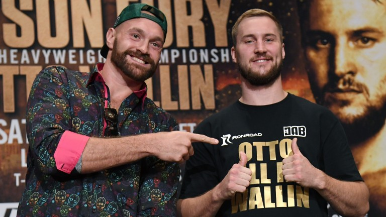 Boxers Tyson Fury and Otto Wallin pose during a news conference at MGM Grand Hotel in Las Vegas