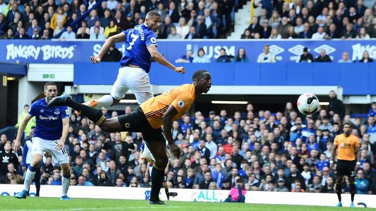 Everton forward Richarlison scores his team's third goal against Wolves