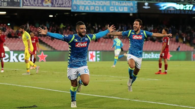 Napoli's Lorenzo Insigne and Simone Verdi celebrate a goal against Liverpool
