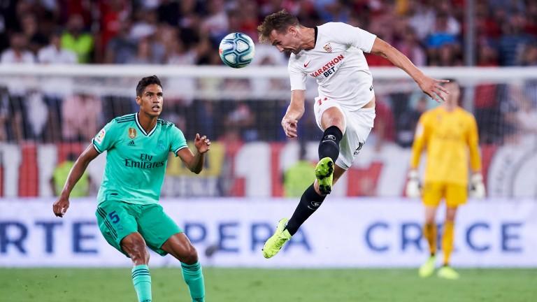 Sevilla's Luuk de Jong gets in a header against Real Madrid