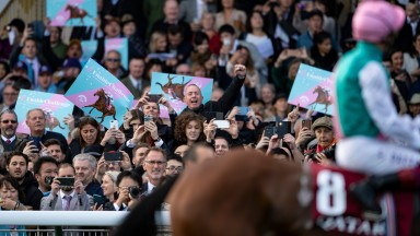 Fans cheer Enable (Frankie Dettori) before the ArcLongchamp 6.10.19 Pic: Edward Whitaker