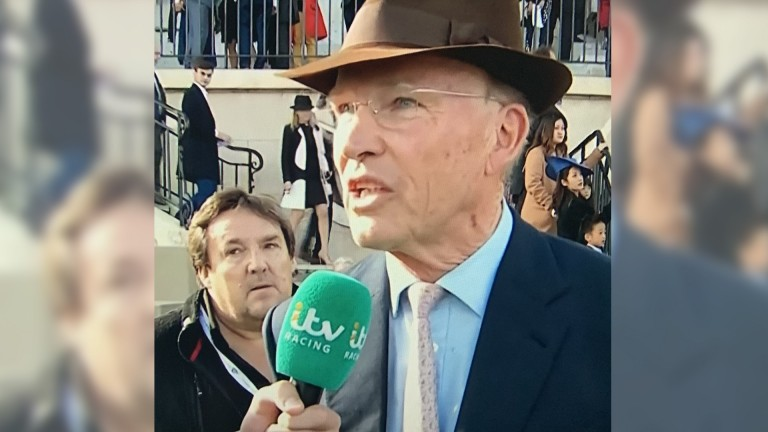Richard Melia appeared in the background behind John Gosden at Longchamp on ITV