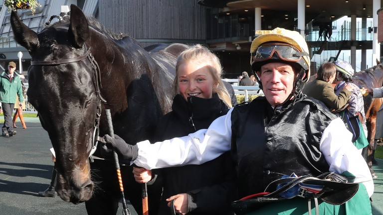 Tony Williams and Cracking Destiny and groom Robyn Crawford in the winner's enclosure after the Aintree charity race