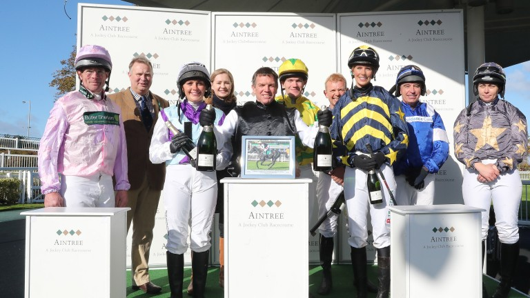 Runners and riders all smiles after completing the Aintree charity race