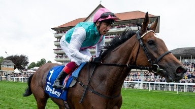 Enable and Frankie Dettori trot past the grandstands after an emotional Yorkshire Oaks success