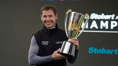 Richard Johnson at Sandown in April with the champion jockey's trophy that some believe he may struggle to hold on to