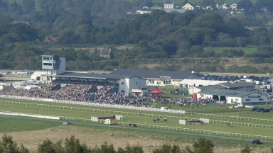 TRIMSARAN, WALES - OCTOBER 10:  A general view as Ixora ridden by jockey Tom O'Brien lead over the last before winning The Crabbies Alcoholic Ginger Beer Mares' 'national Hunt' Maiden Hurdle race during Ffos Las Races at Ffos Las racecourse on October 10,