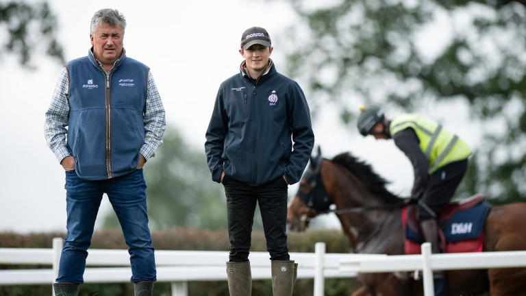 Paul Nicholls with assistant trainer Harry Derham on the Ditcheat gallops