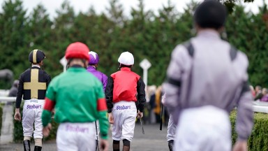 SUNBURY, ENGLAND - OCTOBER 10: A general view as jockeys make their way to the parade ring at Kempton Park Racecourse on October 10, 2019 in Sunbury, England. (Photo by Alan Crowhurst/Getty Images)