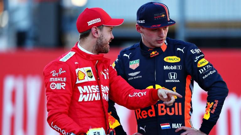 Sebastian Vettel (left) chats to Max Verstappen