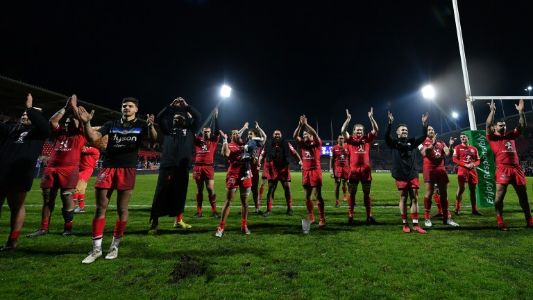 Toulouse players celebrate last season's pool-stage victory over Bath