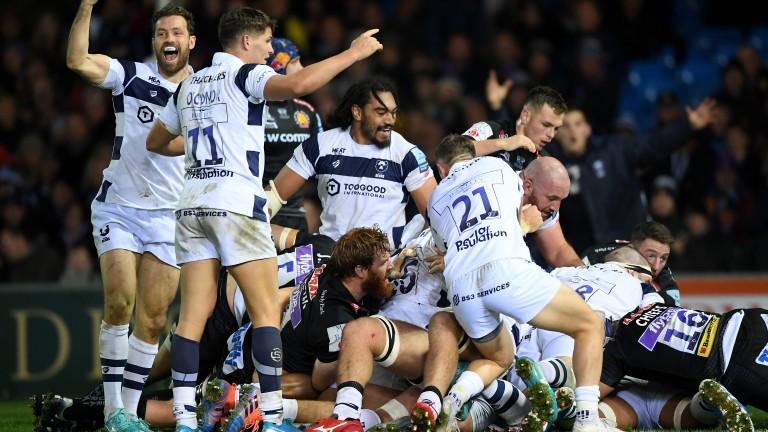 Bristol Bears players celebrate the late try that gave them victory at Exeter on Sunday