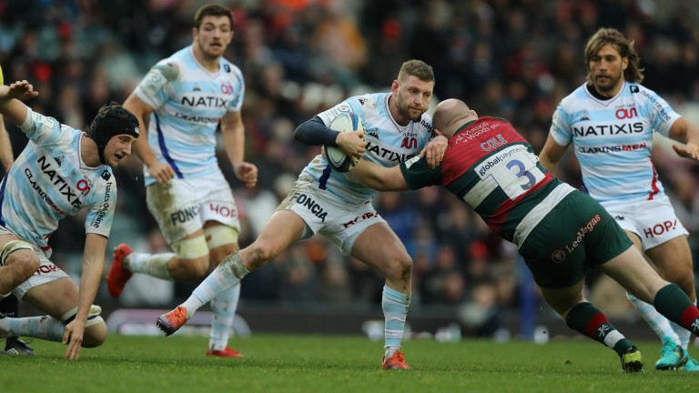 Racing fly-half Finn Russell in action against Leicester