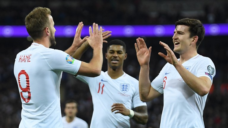 England's Harry Kane celebrates with Harry Maguire after scoring during the UEFA Euro 2020 qualifier against Montenegro