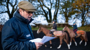 Trainer Alan King issues instructions to 1st lot  as they warm up in the school at Barbury Castle  near Marlborough in Wiltshire 7.11.19 Pic: Edward Whitaker