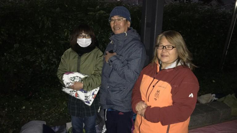 Michiko Takarada, Kenji Yoshida and Lisa Wilson settle down for another night waiting for the Japan Cup