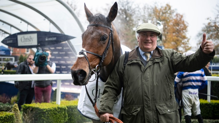Paul Nicholls celebrates after Cyrname's victory in the Christy 1965 Chase