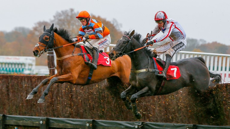 Master Tommytucker (left) jumps the last to beat Who Dares Wins at Kempton on his sole victory over fences