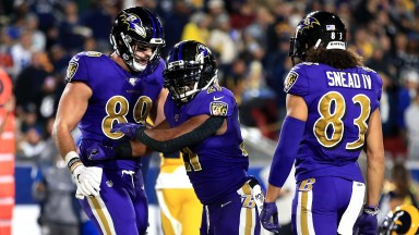 Baltimore running back Mark Ingram (middle) celebrates his touchdown against the Rams last week