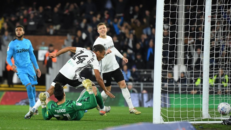 Bobby Reid of Fulham scores against Derby County