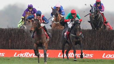 The Conditional chases De Rasher Counter home in the Ladbrokes Trophy