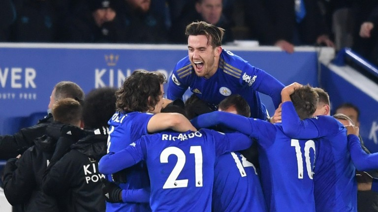 Kelechi Iheanacho is mobbed by his Leicester City team mates