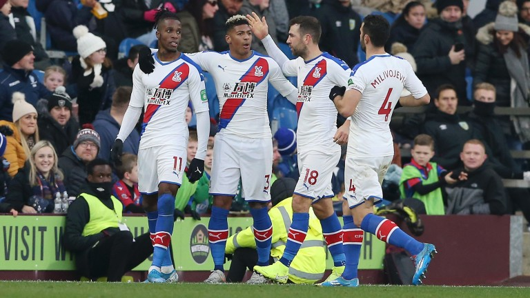 Crystal Palace celebrate Wilfried Zaha's opener in their 2-0 win at Burnley