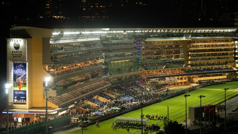 Runners break from the stalls for the 1,650m race in the Longines International Jockeys' Championship meeting at Happy Valley