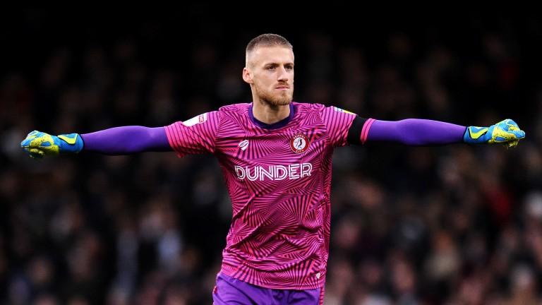Bristol City goalkeeper Daniel Bentley celebrates the Robins' win at Fulham