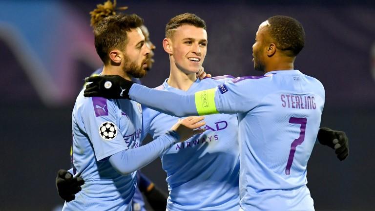 Bernardo Silva and Raheem Sterling join Phil Foden to celebrate his goal last midweek against Dinamo Zagreb