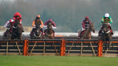 Epatante (Aidan Coleman, right) clears the last in front in the intermediate limited handicap hurdle at Newbury last month