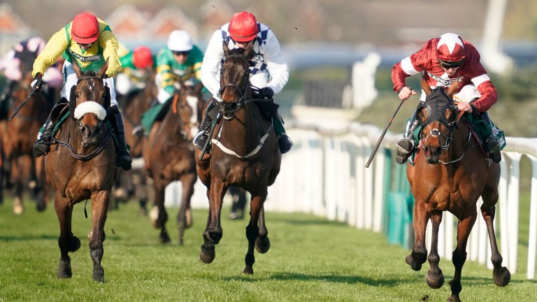 Magic Of Light (left) chases Tiger Roll in Aintree