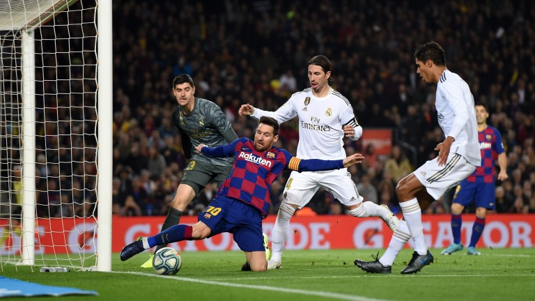 Real Madrid fight to keep Barcelona's Lionel Messi at bay