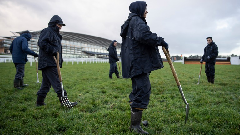 Groundstaff work on the track before the second inspection at Ascot