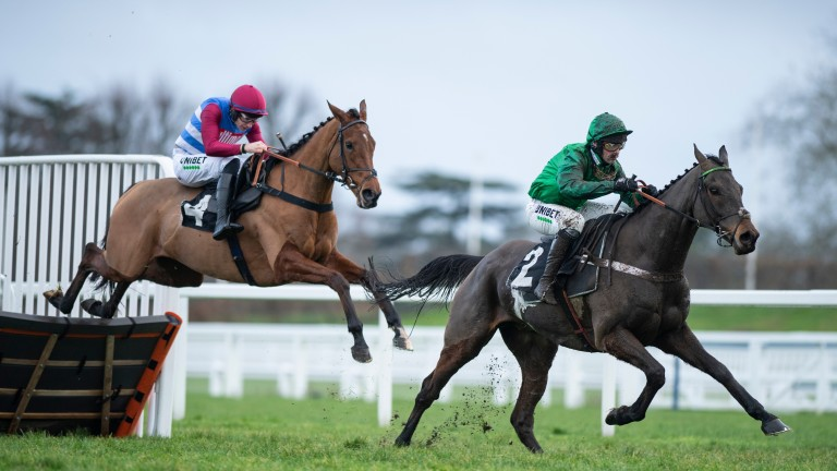 Winner The Worlds End trails L'Ami Serge at the last in the Marsh Hurdle