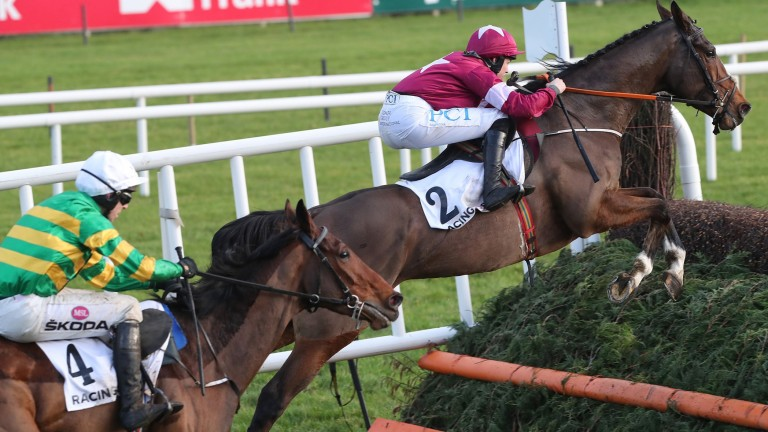 Notebook (leading) puts in another fine leap en route to victory at Christmas