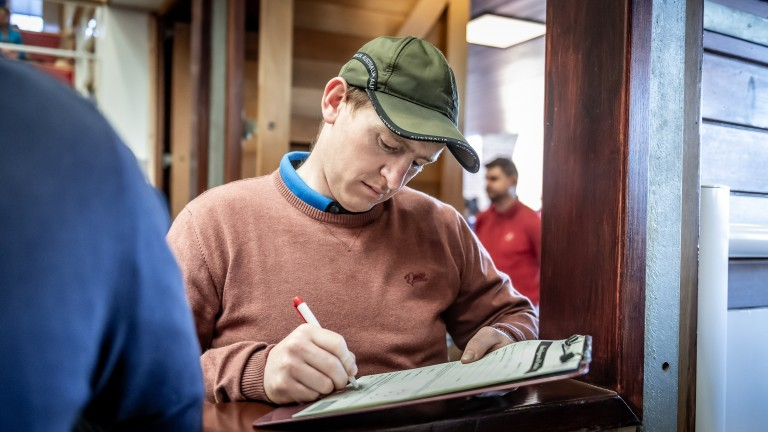 Donnchadh Doyle signs the docket at the Goffs UK Spring Sale