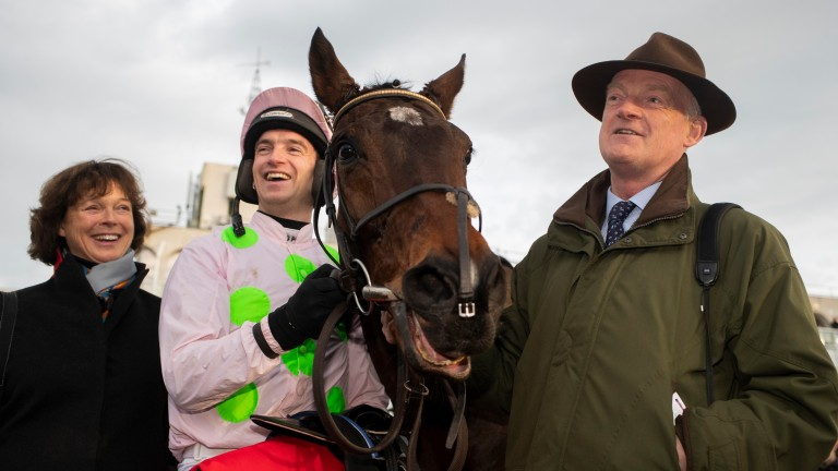 Patrick Mullins: celebrates winning the Matheson Hurdle for a second year running aboard Sharjah alongside his parents Jackie and Willie Mullins