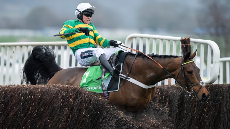 Champ ploughs through the second-last under Barry Geraghty, coming down with the race at his mercy