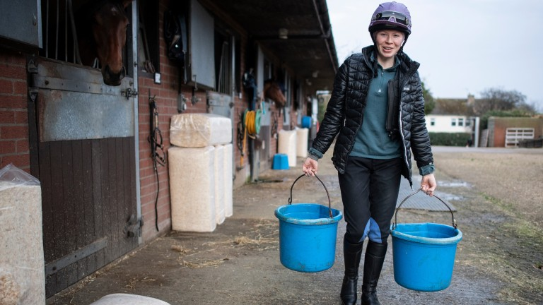 Rosie Margarson, who works for her father George, at Graham Lodge Stables in Newmarket