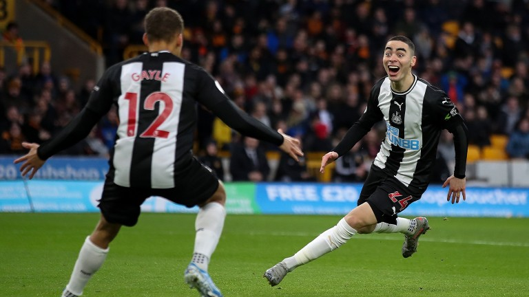 Newcastle United's Miguel Almiron celebrates a goal with Dwight Gayle