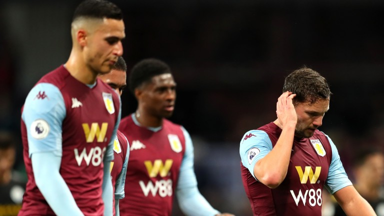 Aston Villa players trudge off after being whacked by Manchester City