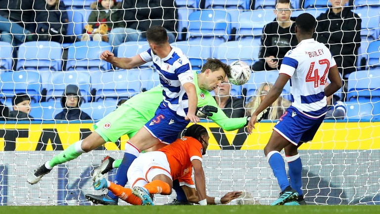 Nathan Delfouneso scores Blackpool's first goal during the FA Cup third round match against Reading
