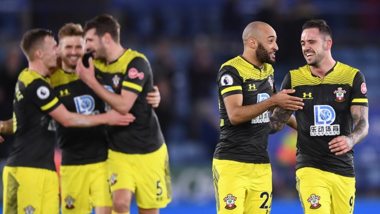 Danny Ings and Nathan Redmond (right) celebrate Southampton's win at Leicester City