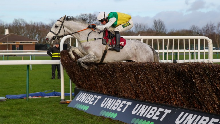 Vintage Clouds: puts in a fine leap to run out an impressive winner of the Peter Marsh Chase
